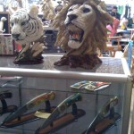 Lion and tiger heads with assorted knives